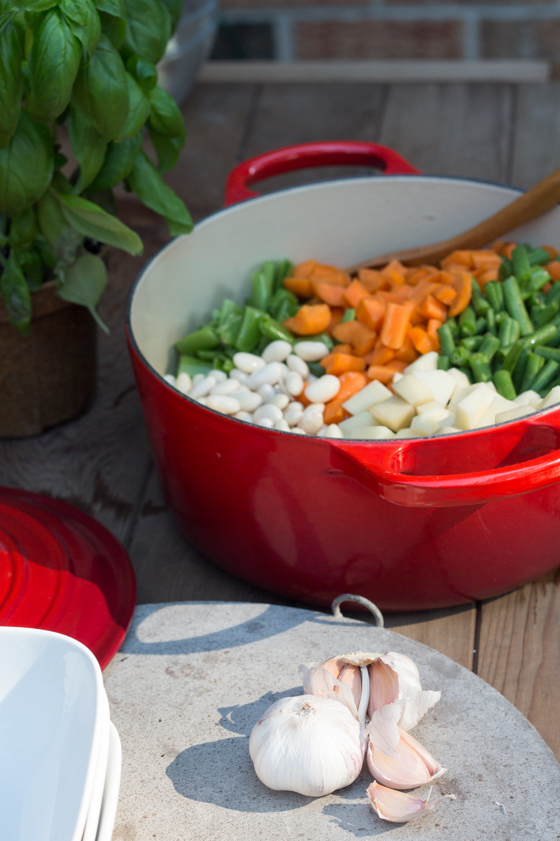 Red pot with all the beans for Pistou soup and garlic