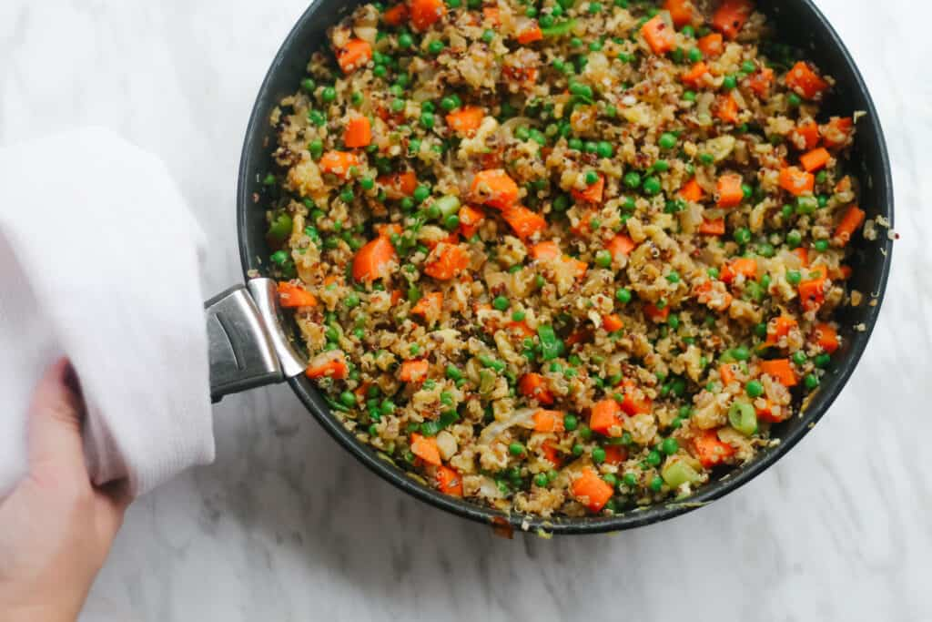 Quinoa fried rice ready to be served in a pan