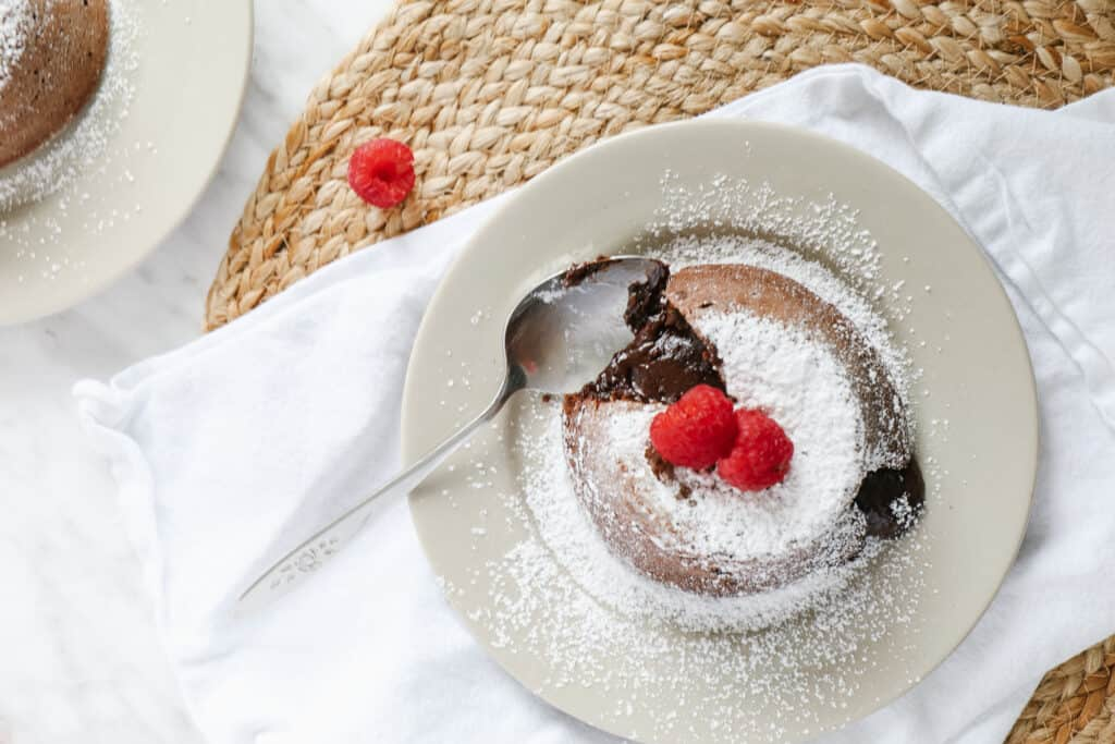 Top view of 2 lava cakes with raspberries