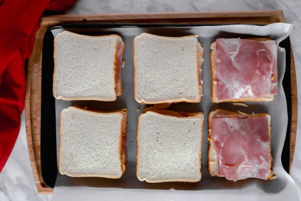 Top view of ham and bread on a baking sheet